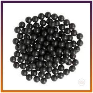 Forty-three black rubber balls 500 caliber projectile shells.